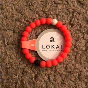 Neon pink Lokai bracelet